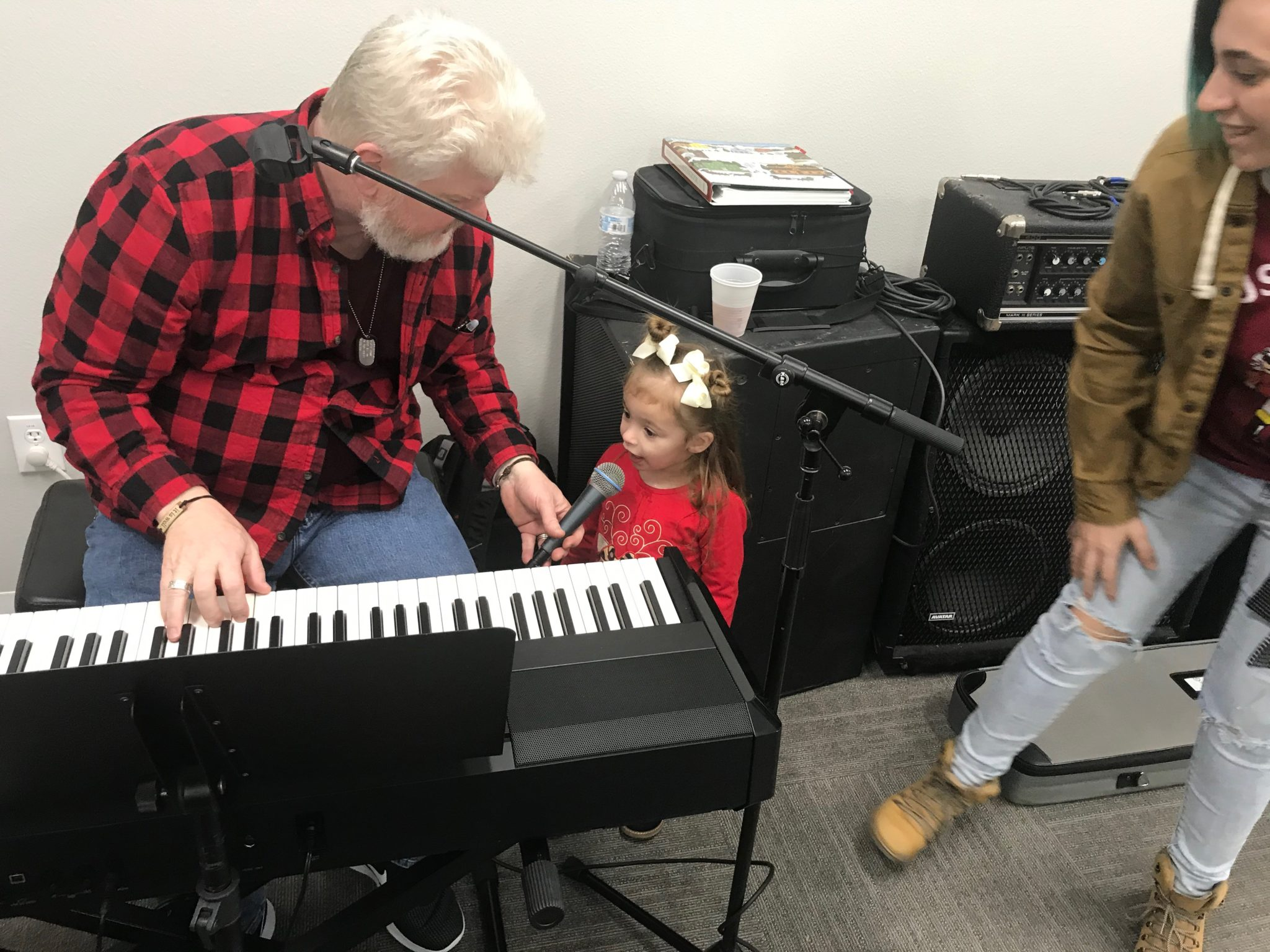 playing keyboard at SONTX 2019 Christmas Party