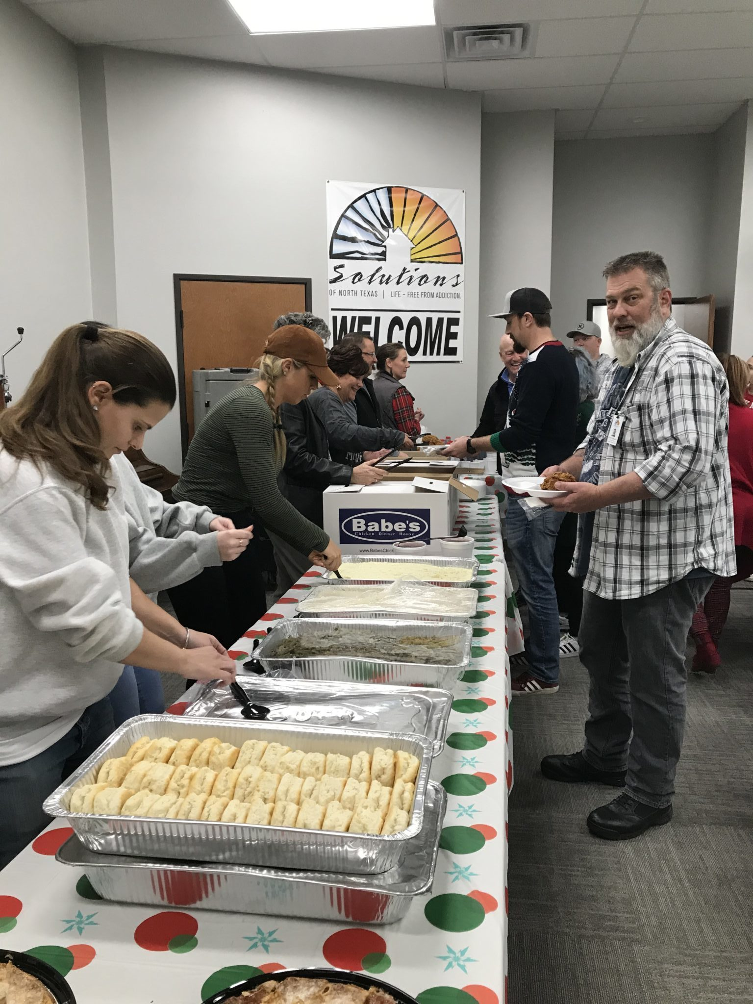 serving food at SONTX 2019 Christmas Party - Solutions of North Texas - Collin County Intervention