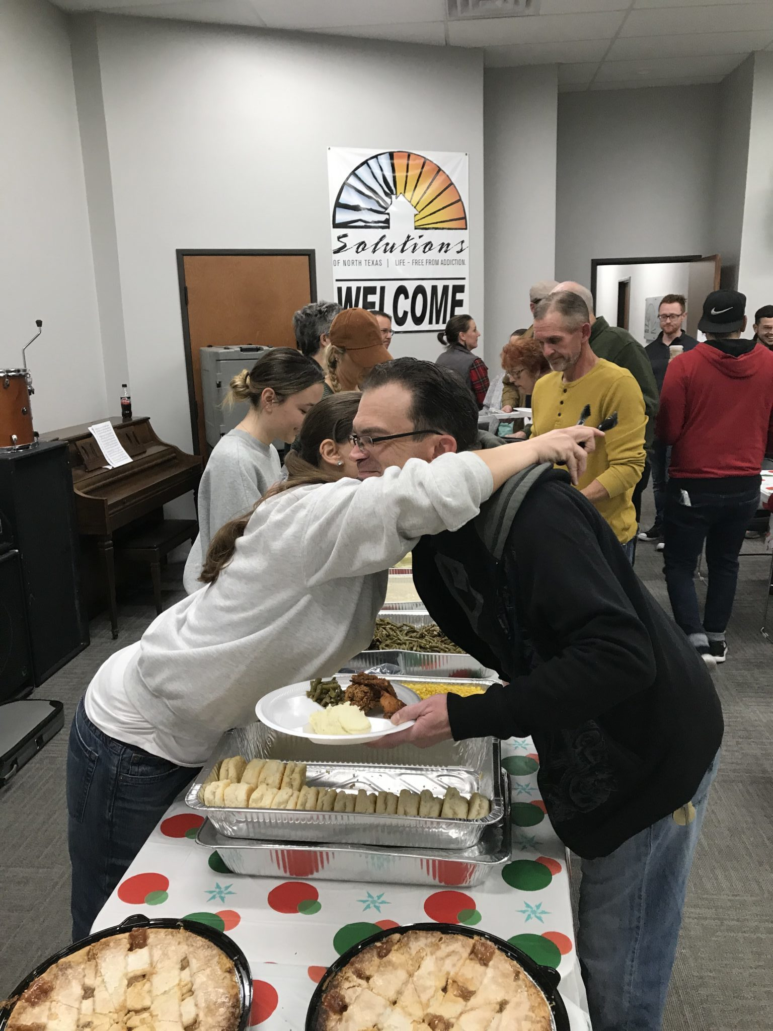 serving food at SONTX 2019 Christmas Party - Solutions of North Texas - Tarrant County Sober Living