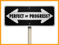 street sign with arrows - perfect one direction and progress the other - perfectionism